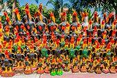 rooster statues offerings at Wat Yai Chai Mongkhon Ayutthaya Bangkok Thailand
