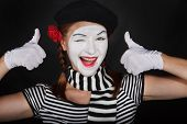 stock photo of clown rose  - Portrait of a happy mime comedianon black background - JPG