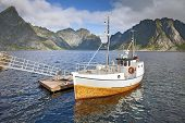 picture of lofoten  - Traditional norwegian fishing boat by pier on Lofoten Islands in Norway - JPG