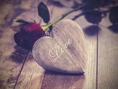 Vintage Picture Of Heart On A Wooden Background With Red Rose. Valentine's Day Symbol.