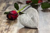 Valentine's Day Symbol. Heart On A Wooden Background With Red Rose.