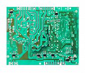 stock photo of transistor  - green electrical circuit board with conductors and transistors - JPG