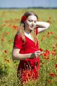 Woman At Dress Holding Poppies Blossoms