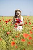 Woman At White Dress Adjust Poppy Bouquet