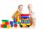 Two Little Children Play With Block Toys