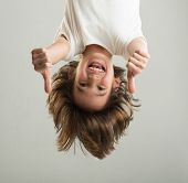 image of upside  - Little boy hanging upside down - JPG