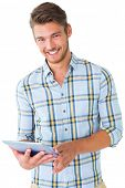 Handsome young man using his tablet pc on white background