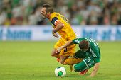 VIENNA, AUSTRIA - AUGUST 8 Marcel Sabitzer (#24 Rapid) and Usero (#8 Asteras) fight for the ball at