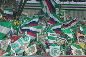 VIENNA, AUSTRIA - AUGUST 8 Fans of SK Rapid show their flags at a UEFA Europa League game on August