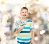financial, planning, childhood and holidays concept - smiling boy holding dollar cash money in his h