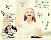 education and school concept - little student girl with books raising hand up at school