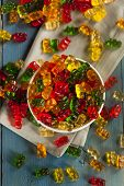 stock photo of gummy bear  - Colorful Fruity Gummy Bears Ready to Eat - JPG