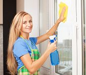 Woman washing window. Housewife cleaning window at home. Housework