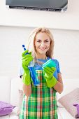 Woman cleaning house. Housewife at home