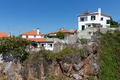 Houses Build At A Cliff At Funchal, Madeira Island