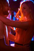 Sweethearts dancing together in the night club