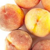 Ripe peaches isolated over white background