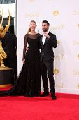 LOS ANGELES - AUG 25:  Behati Prinsloo, Adam Levine at the 2014 Primetime Emmy Awards - Arrivals at
