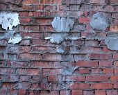 Texture Of Red Brick Wall With Cement Patches