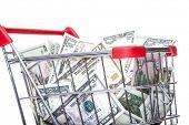 Shopping cart full of US dollar notes