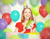 Happy Girl Celebrating Birthday With Balloons And Gifts