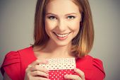 Beauty Girl In Red Dress With Gift Box To Birthday Or Valentine's Day