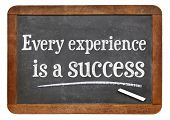 every experience is a success - motivational statement on a vintage slate blackboard