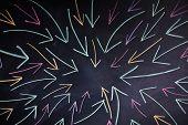 colorful arrows on blackboard background