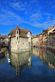 ANNECY, FRANCE - SEPTEMBER 17, 2012: Clear early morning. The bastion turned into prison, is reflect