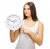 Young girl with clocks isolated