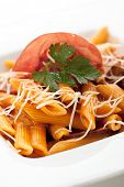 Pasta Penne with Bolognese Sauce. Garnished with Parsley, Sliced Meat and Parsley