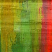 art abstract colorful silk textured blurred background in green, red and gold colors