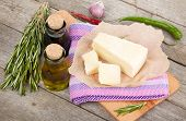 Parmesan cheese, herbs and spices on wooden table background