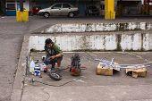 Spraying Metal Frame in Banos, Ecuador