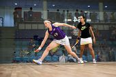 AUGUST 19, 2014 - KUALA LUMPUR, MALAYSIA: Sarah-Jane Perry of England (purple top) hits a return while playing Nouran Gohar (Egypt) in the CIMB Malaysian Open Squash Championship 2014.