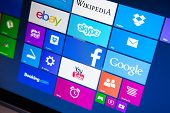 WROCLAW, POLAND - AUGUST 26, 2014: Photo of a Windows 8.1 operated laptop - start screen with most popular apps
