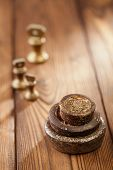 Vintage  iron and brass kitchen  weights on old wooden table