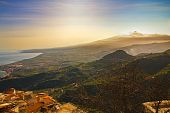Mount Etna And Sea At Sunset; Landscape From Castelmola