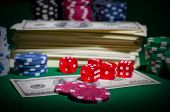 Playing chips dices and dollars on green table