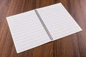 Blank musical notes book mock up on wood background
