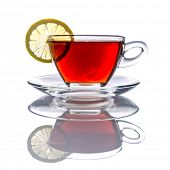 Cup of tea with lemon over white