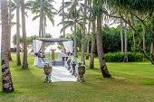 beautiful wedding cabana, arch, outdoor wedding in tropics