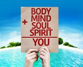 Body + Mind + Soul + Spirit = You card with a beach on background