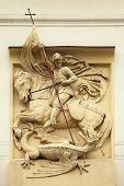 Saint George killing the Dragon. Stucco decoration on the Art Nouveau building in Prague, Czech Republic.