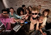 stock photo of lps  - DJ crowded by fans and requests at a party - JPG