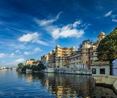 Romantic India luxury tourism concept background - Udaipur City Palace and Lake Pichola. Udaipur, Rajasthan, India