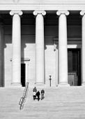 National Archives in Washington DC with columns and people walking up stairs