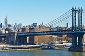stock photo of brooklyn bridge  - Manhattan Bridge and skyline view from Brooklyn Bridge in New York City - JPG