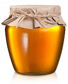 Glass can full of honey.