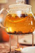 teapot of herbal tea on table